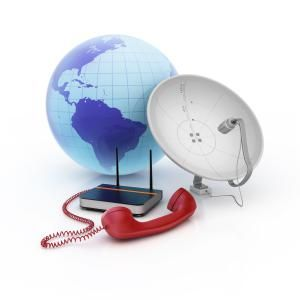 Do wireless providers offer better Internet service?: Group of modern telecommunication equipments, globe with telephone, modem and internet and satellite dish media