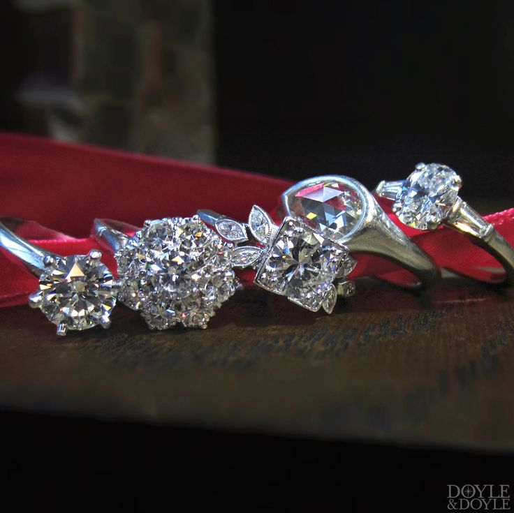 A diamond for everyone! Stack of five vintage diamond engagement rings in platinum, all from Doyle & Doyle.