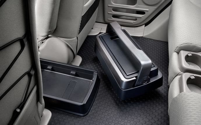The Honda Element had a built-in ice chest that locked into a special shoe on the floorboard between the front seats. Hello! That is BRILLIANT!