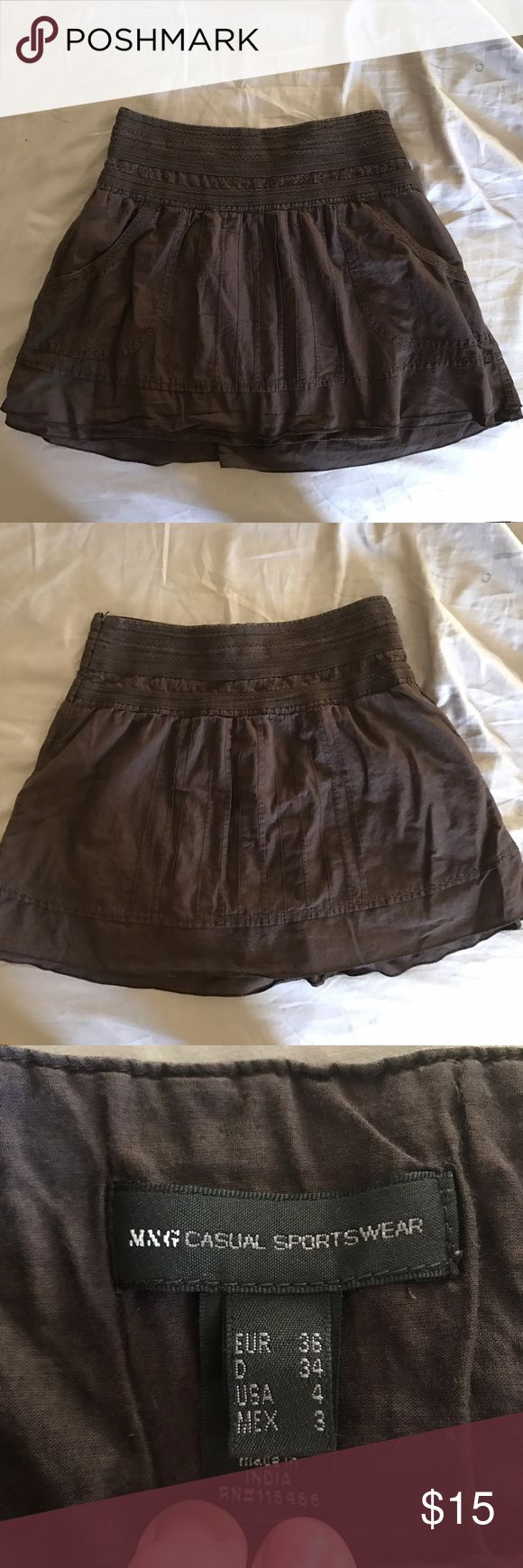 Mango skirt with pockets From the Spanish company Mango. Chocolate brown boho skirt with front pockets! Cute embroidered detail. In EUC Mango Skirts Mini