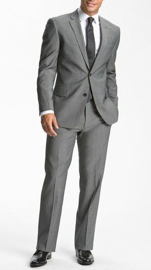 Revel: This grey wool suit from John Varvatos is just what your groom needs for the big day! Pairs a classic notched-lapel jacket with easily alterable flat-front trousers. Jacket has double-button closure, four-button cuffs, chest pocket, flap pockets, three interior pockets, and side vents. Trousers have front slant pockets and back button-closure welt pockets.