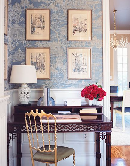 blue toile wallpaper, white chinoiserie lamp, gold chair, mahogany desk