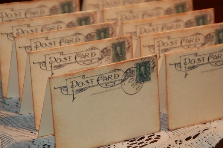 Love this idea for escort cards if tables are themed by places visted 100 - Wedding Place Cards - Vintage Post Cards Placecards - Escort Cards - Tent Table Place Cards. $60.00, via Etsy.