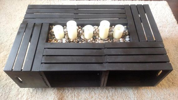 Beautiful handmade coffee table crafted from wooden crates - will make a unique addition to any home and provide ample storage.  Dimensions 45.5 L x
