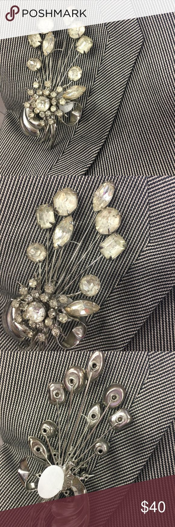 Spring into action! A beautiful vintage brooch 🌹 5.5 inches of vintage glamour! Silver and clear stones, smashing on a lapel or sweater, it is brilliant on anything! ***note signs of wear, a vintage piece*** Vivian's Closet Jewelry Brooches