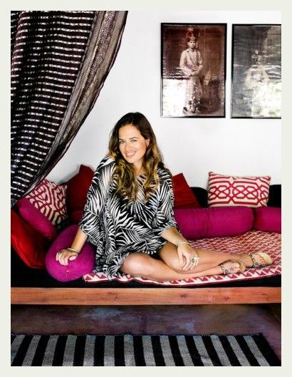 Jade Jagger's Goa beach home. Hot pink and red pillows mixed with a stripped black rug and curtain
