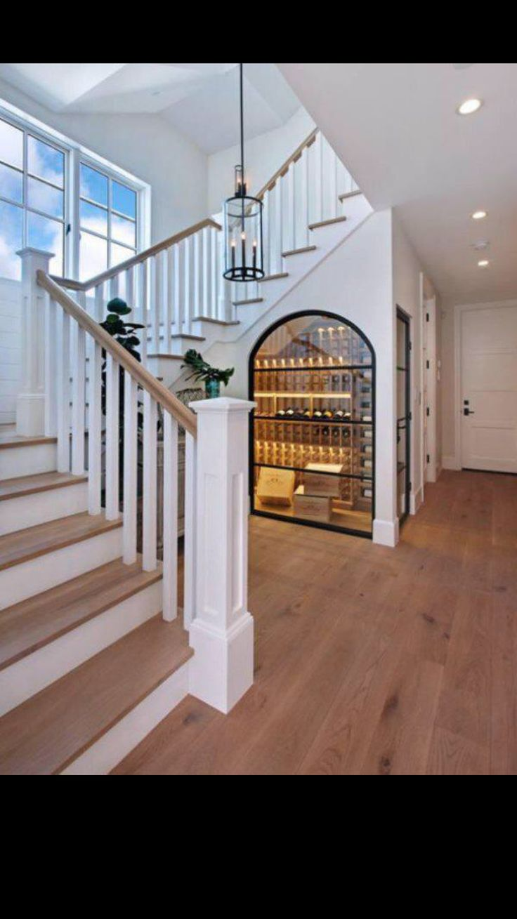 Foyer and under-the-stairs wine cellar.
