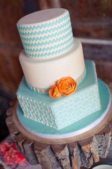Blue, white, tangerine wedding cake!