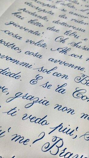 Copperplate calligraphy exercises in blue ink.