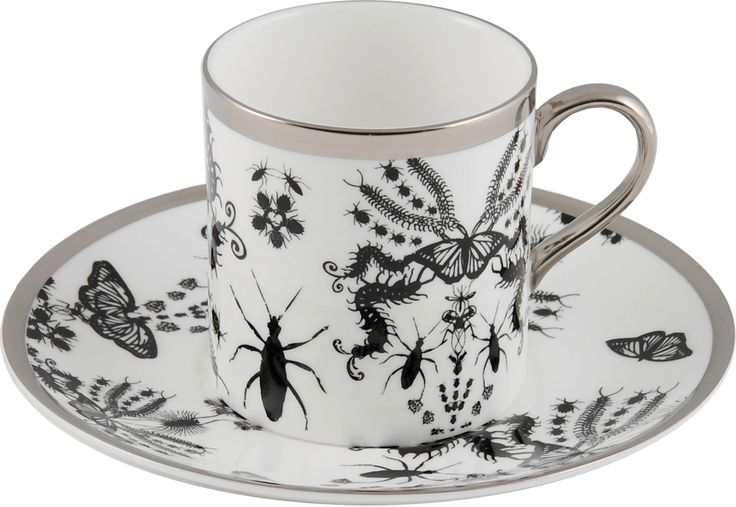 A diverse and cool Espresso Cup & Saucer taken from the 'Entomo' Black collection. Entomo presents an array of some of the most important yet often misunderstood creatures on our planet. From gossamer wings of the butterfly to the architectural magnificence of the stag beetle, together a pattern of wonderment and delight. Designed by Monica Tsang. Handwash Only. Hand gilded platinum rim and handle. Available in Black and Platinum. Made in Stoke-on-Trent, England. Fine Bone China. Find out…