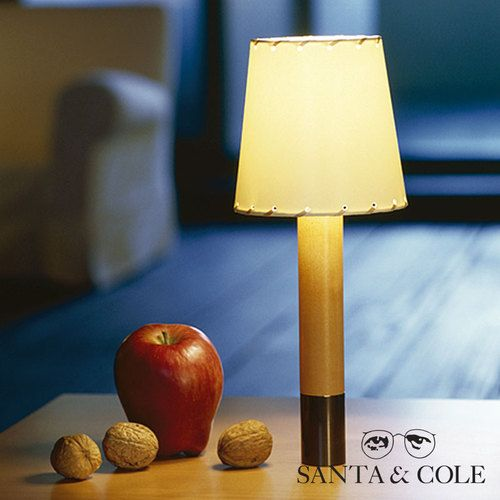 The Santa & Cole Basica Minima Table Lamp is a pocket edition of Basica lamp bringing its family character to use requiring a smaller size or less intensive light, such as bedside tables or reference lights.