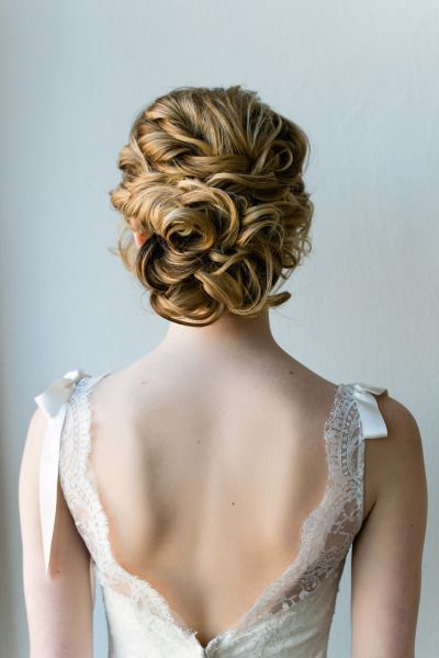 Whimsical wedding updo with low back dress. Let Vênsette's world-class hair and makeup artists craft custom beauty looks for your special day: http://vensette.com/bridal_inquiries