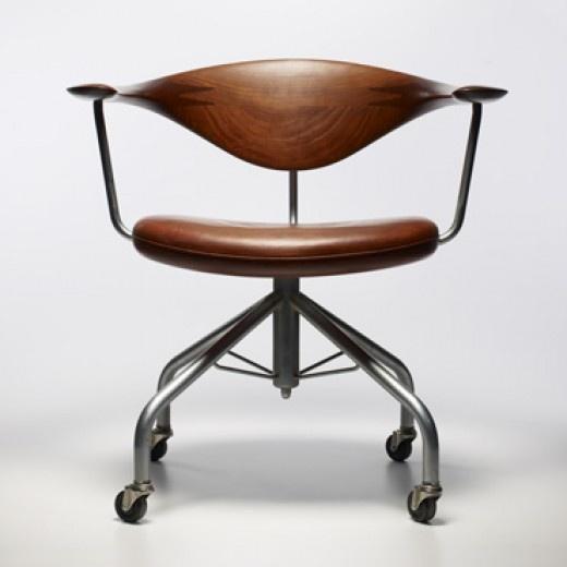HANS WEGNER    Swivel chair, model 50    Johannes Hansen  Denmark, 1955  teak, leather, chrome-plated steel  29 w x 21 d x 28.75 h inches