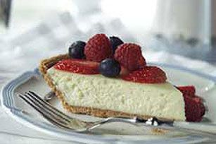 Amaretto Berry Cheesecake  2 pkg. (8 oz. each) PHILADELPHIA softened 1/2 cup  sugar 1/2 tsp.  vanilla 3 Tbsp.  almond-flavored liqueur 2  eggs 1  ready-to-use graham cracker crumb crust (6 oz.) 2 cups  mixed berries (blueberries, raspberries and sliced strawberries) or just bleuberries.