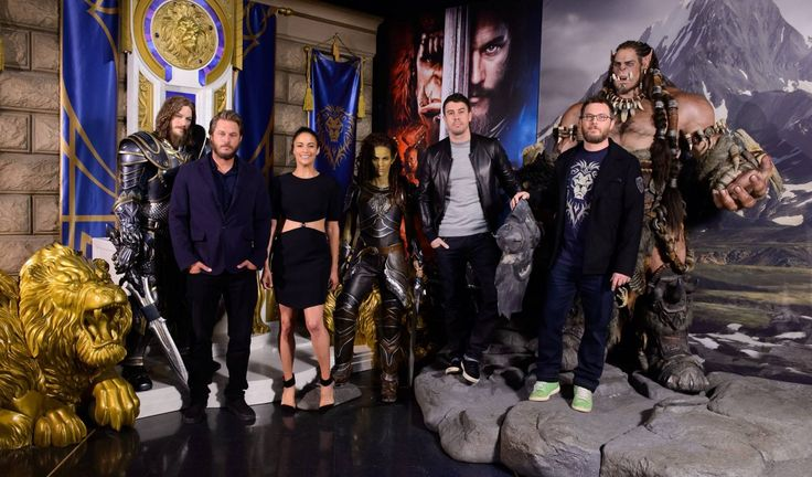 Cast and crew of Warcraft film.  A good reference-scale for prop making. Use the human head as a baseline: Orcs stand between one and two heads taller than a human. Orc palms look like they're about as wide as a human head.