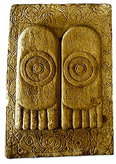Stone panel depicting footprints of the Buddha,  Mauryan period, 1st centry BCE. from greqa stupa at amaravati, guntur district, andhra pradesh sandstone. This is transferred from the India Museum. The wheels on the center of each foot are representations of the Dharmachakras, the wheel of the law. A closer examination reveals  presence of triratnas (the three jewels)