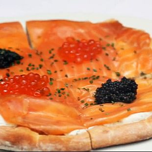 Get the Dish: Wolfgang Puck's Smoked Salmon Pizza: Each year, Hollywood's A-listers are served Wolfgang Puck's signature smoked salmon and caviar pizza at the annual Oscars Governors Ball — and now you have a chance to taste it, too!