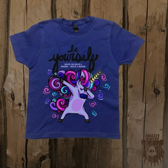 Be Yourself Unicorn Dab Dance Kids Shirt Be yourself! Unless you can be a Unicorn... then be a Unicorn.Get our original design in your choice of Grey, Blueor White.  Materials:  100% USA Ring Spun Cotton (Much softer than combed cotton) Childrens Tultex Preshrunk Tee Tear-Away Tag Printed Direct To Garment 30 Thread CountNo Side Seams  *Grey is made of 90% Ring Spun Cotton, 10% Grizzly Where Shirts & Tops Tees - Short Sleeve