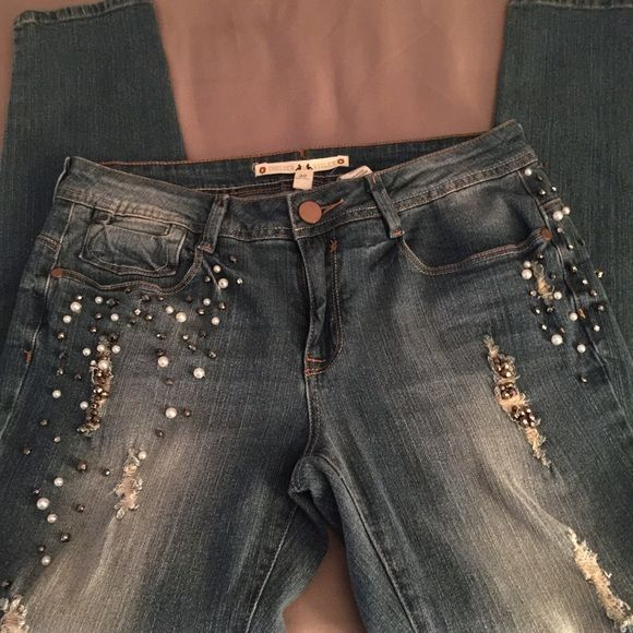 Chelsea Violet Designer Jeans Slim Fit Slim fit jeans with faux pearls and rhinestones on sides and a little in back. These jeans are a slim fit . Chelsea & Violet Pants
