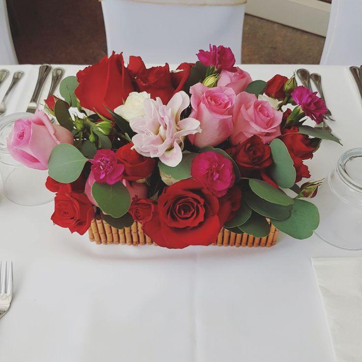 Roses, double petal lilies arrangement