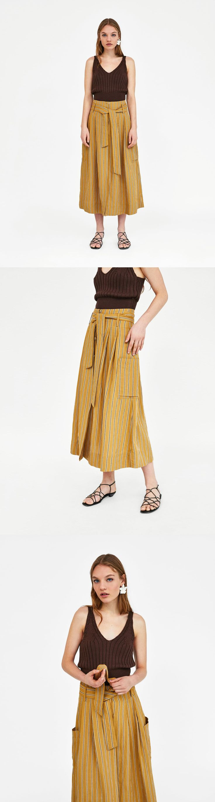 Linen Skirt With Bow Detail // 69.90 USD // Zara // High waist midi skirt with a bow detail in matching fabric. Features side patch pockets, front pleats, a wide A-line silhouette and button fastening in the front hidden by a placket. HEIGHT OF MODEL: 178 cm. / 5′ 10″