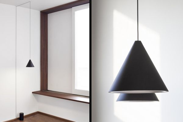 A conical LED suspension lamp in the conical model. String lights by Michael Anastassiades