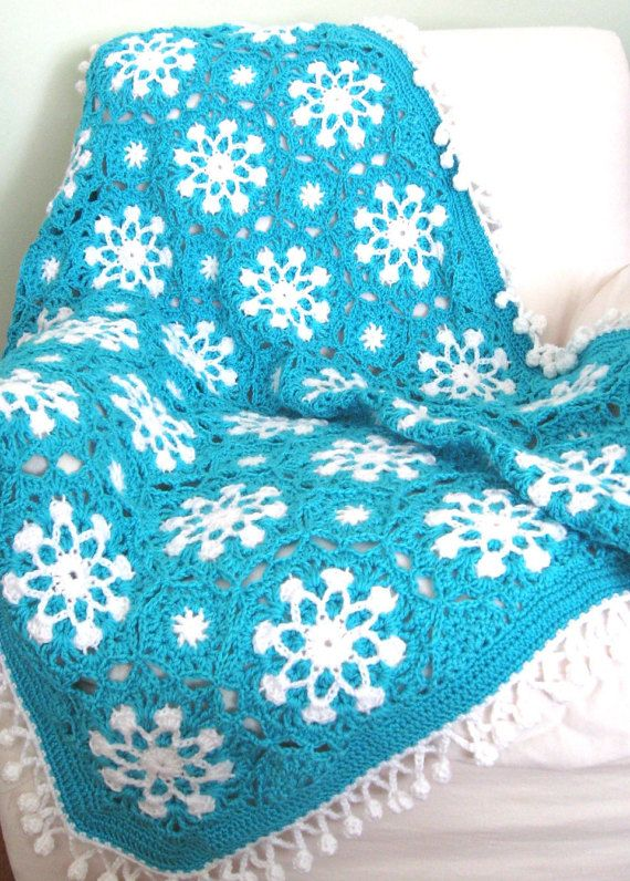 This Crochet Snowflake Afghan Pattern is Free at Red Hearts Website.