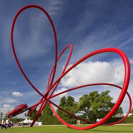 The sculpture marked the car brand's centenary and features two iconic Alfa Romeo cars, from the past and present, at the end of a series of loops.