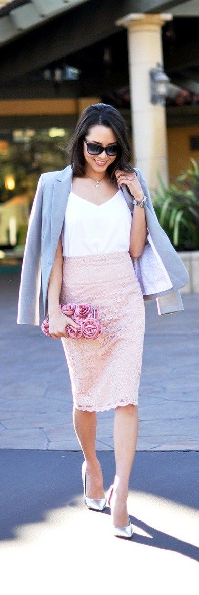 White lingerie inspired top is tucked in blush lace pencil skirt and Blue Blazer.