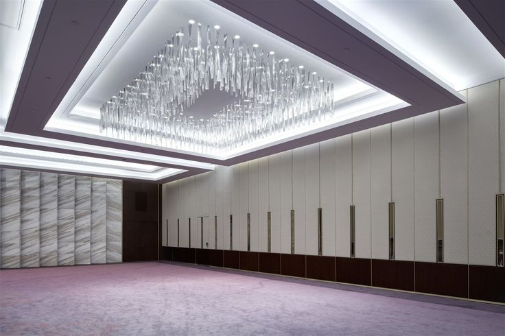 The meeting rooms of the Convention Center in Baku adore almost three thousand hand-made twisted leaves in clear, light, and dark grey colours and more than one thousand high-quality optical glass tubes. In collaboration with HBA Interior Designers from Dubai.  #light #lighting #design #designlighting #interior #staircase #chandelier #hospitality #hotel #conferenceroom