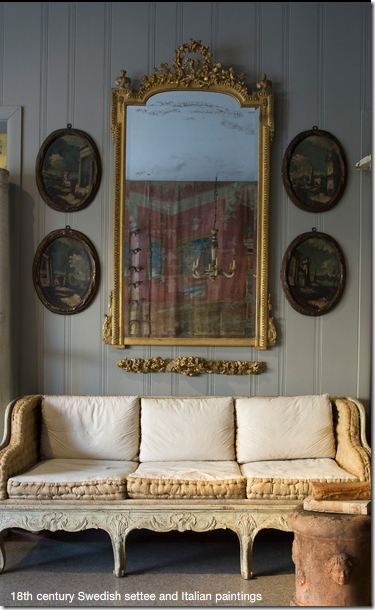 the oval paintings perfectly balance the antique mirror...