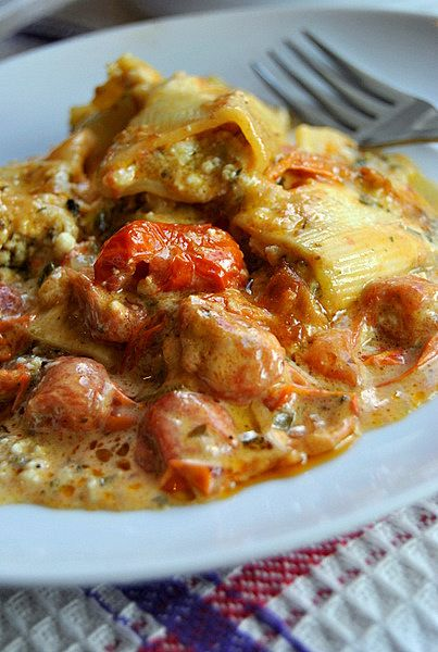 Ricotta and parsley filled paccheri baked with a tomato, butter and sage sauce. Yum-ah-dum-dum!