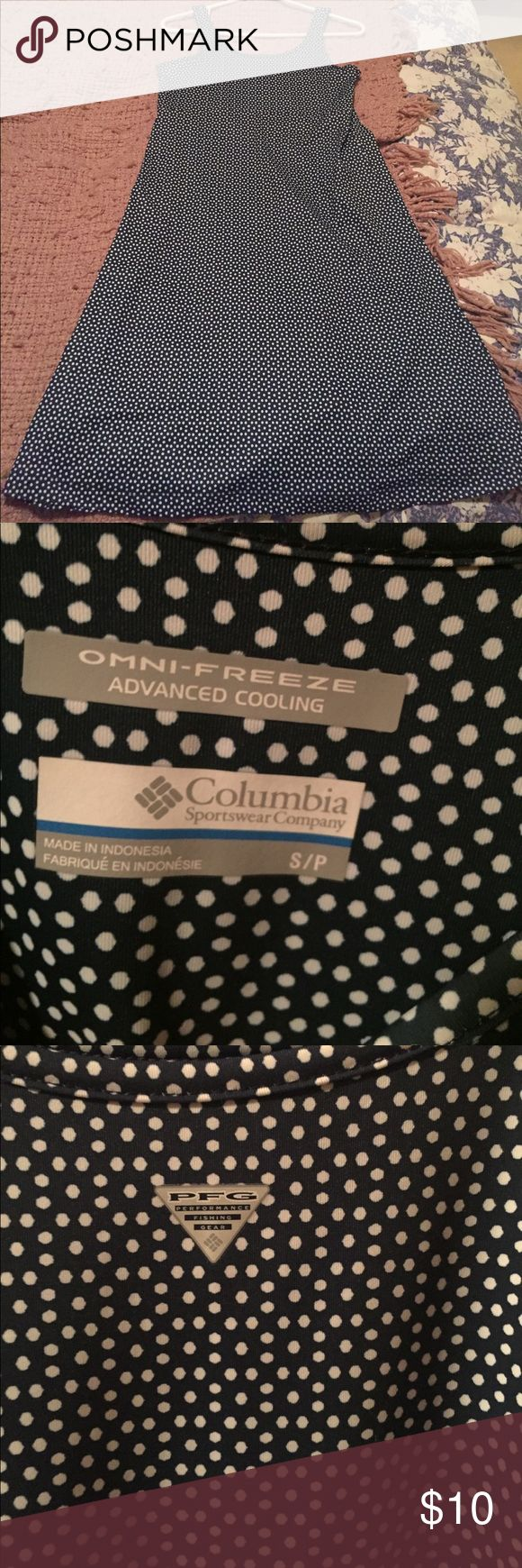 Columbia sportswear dress Excellent condition I might have worn it twice. Light weight fabric to keep you cool. Not clingy at all. Navy blue with white polka dots. Part of Columbia's performance gear collection. Fitted up top with a flare from chest to hem. First two photos are stock photos to show fit.  Same dress in those just different pattern. Columbia Dresses