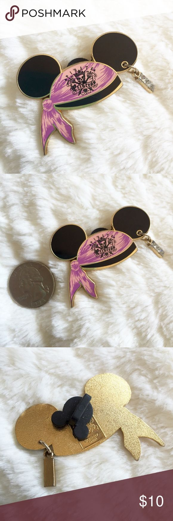 """Authentic Disney Pirates Mickey Hat Trading Pin Authentic Disney Trading Pin • From the Disneyland park • Pirates of the Caribbean themed Mickey hat with a pink bandana that says """"Pirate Princess"""" and a rhinestone ear piercing • Gold tone metal • Year 2007 Disney Accessories"""