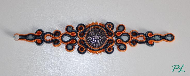 Bracciale con bottone gioiello centrale, pietre sfaccettate arancio e pietre azzurrine lungo 18 cm by Paola Longo creazioni https://www.facebook.com/pages/Paola-Longo-creazioni/615398268566782?fref=ts