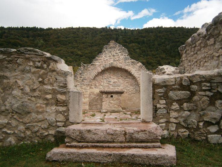 Church altar in the ruins at the St Martino archaeological site, 1050m above sea level, Vigo Lomaso, Trentino, Italy