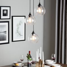 love the light!  Overstock $171 Uptown 3-light clear globe cluster pendant Create a metro-modern look in your home with the addition of this Uptown 3-light cluster pendant. Three unique lights are artfully suspended at various heights with clear globe shades housing unique Edison-style bulbs for a timeless design.