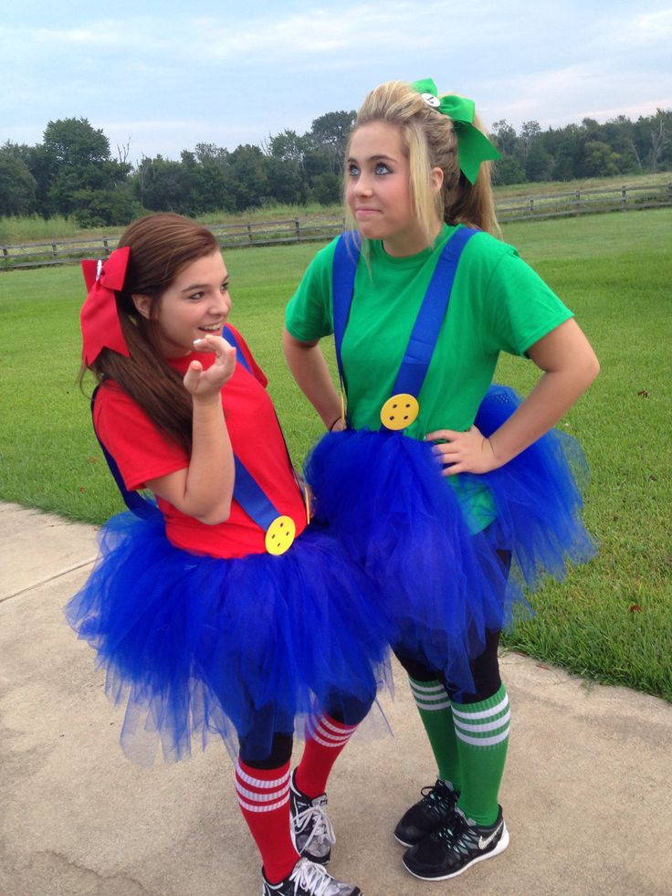 Twin Day for spirit week / homecoming week. Mario and Luigi...fraternal twins! DIY now sew tutu, ribbon suspenders, wooden circles with holes drilled and painted yellow to look like giant yellow button, bows with character initial. Easy and cute costume for school.