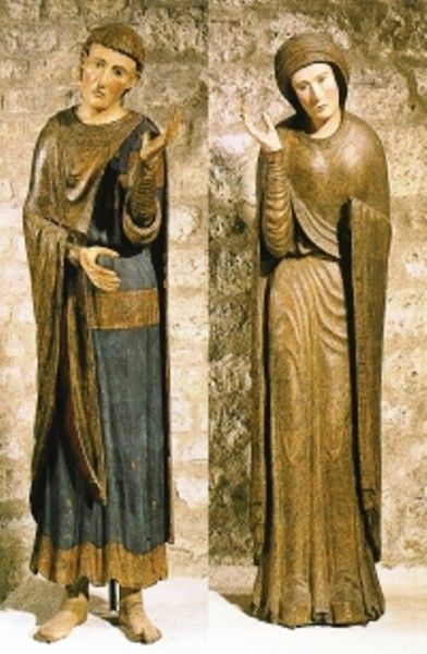An amazingly intact pair of late 12th century polychrome (painted) wood sculptures depicting cloaks and clothing typical of the period.