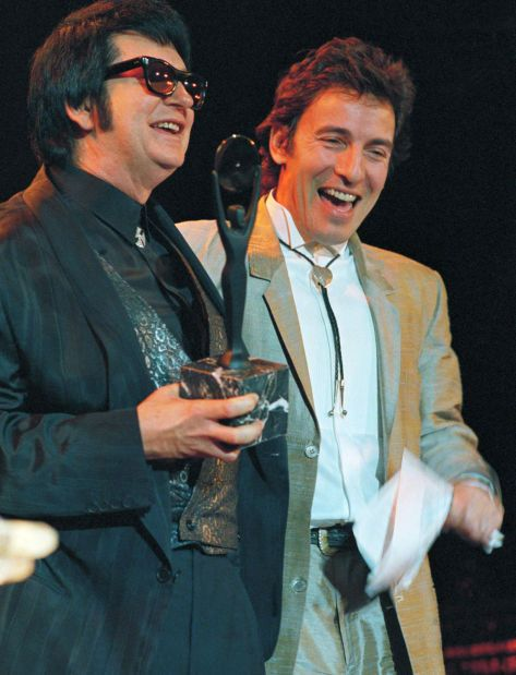 Roy Orbison (left) and Bruce Springsteen share a laugh after Springsteen introduced Orbison at the Rock and Roll Hall of Fame induction ceremony in January 1987.