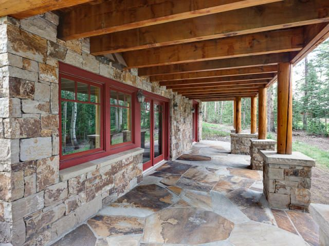 Stone fa ade patio and post foundations daylighting for for Walkout basement patio ideas