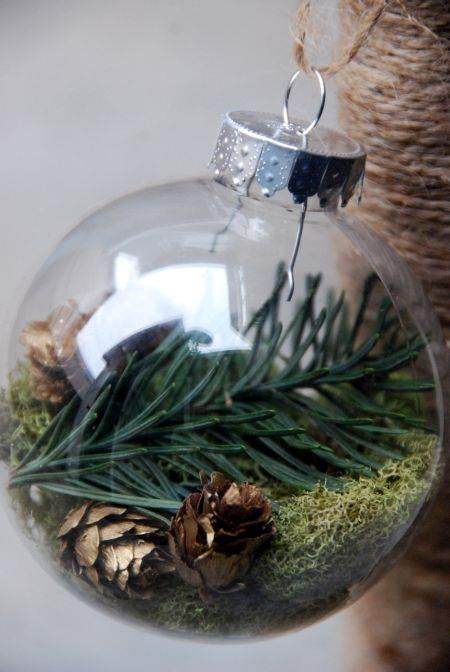 A nature holiday tree- trunk wrapped with natural twine-clear balls with moss & sprigs of Christmas greenery.