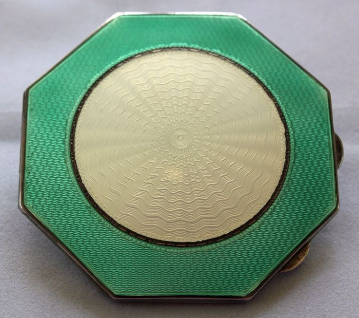 A SILVER AND ENAMEL POWDER COMPACT FROM 1937