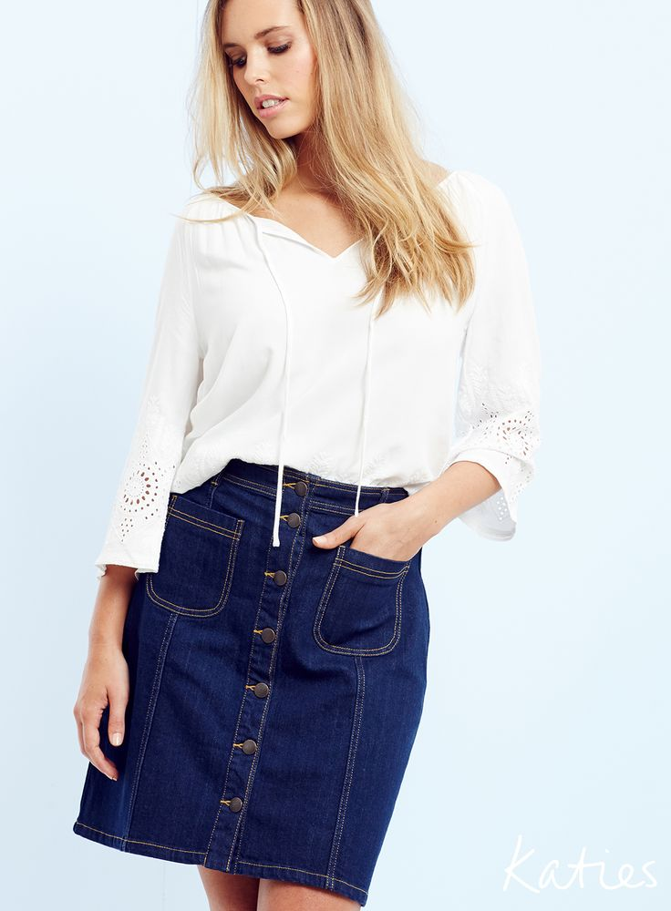 THE DENIM SKIRT / Look new season now with this summer essential. It's A-line shape, front button and pocket details flatter, while the dark wash makes it effortlessly transition from day to night.