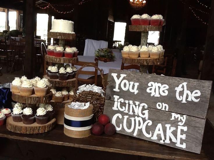 Rustic wedding cupcake display.