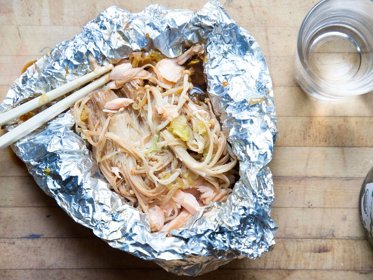 Your new favorite way to cook salmon: with Asian sauces, scallions, and enoki mushrooms, all wrapped up in a foil pouch.