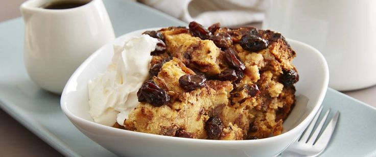 family with warm cinnamon-raisin bread pudding drizzled with maple ...