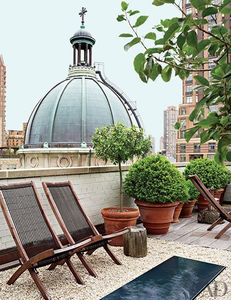 The New York City terrace of antiques dealers Angus Wilkie and Len Morgan overlooks St. Jean Baptiste Church. | archdigest.com