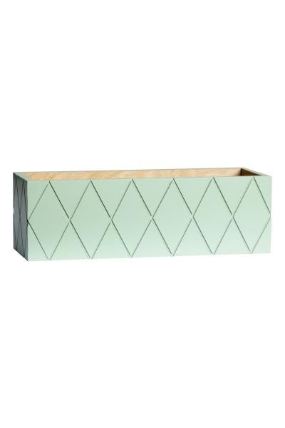Rectangular wooden box: Rectangular wooden box with painted sides and a milled pattern. Size 9.5x10x30 cm.