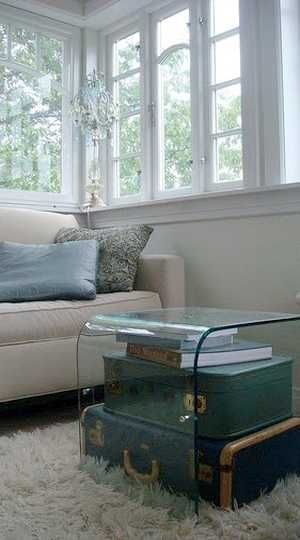 Old suitcases with glass cover-- functional coffee table